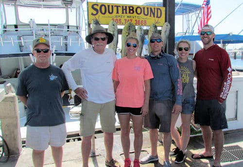 Happy people back from a day Dolphin fishing on the Southbound in Key West Florida