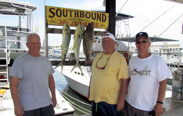 Couple dolphin and a black grouper caught in Key West fishing on charter boat Southbound