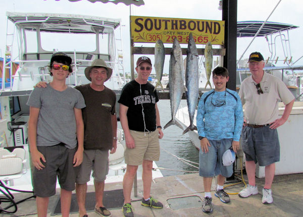 Couple big Kingfish and a couple Dolphin caught in Key West fishing on charter boat Southbound